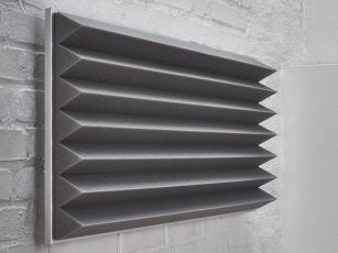 Ljudabsorbent med trekantsprofil